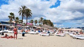Sunbathers in Platja den Bossa beach in Ibiza Town, Spain Stock Photo