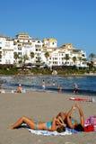 Sunbathers on Puerto Banus Beach. Stock Photography