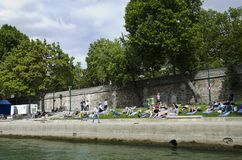 Sunbathers on the Seine Embankment, Paris, France Royalty Free Stock Photo