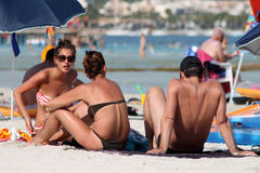 Sunbathers on Spanish beach Stock Photography