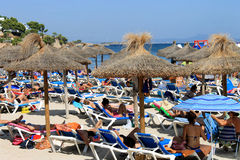 Sunbathers on a Spanish beach in summer Royalty Free Stock Photo