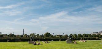 Sunbathers on the Tuileries lawn, Paris Stock Photo