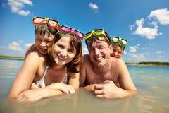 Sunbathers in water Stock Photos
