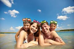Sunbathers in water Royalty Free Stock Photography