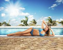 Sunbathes on poolside Stock Photo