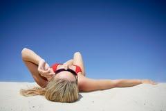 sunbathing женщина Стоковая Фотография