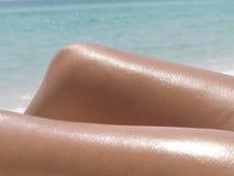 Sunbathing. Photo of female sunbather on Grayton Beach, FLA, overlooking the Gulf of Mexico stock images