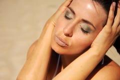 Sunbathing. Female face with stone lips sunbathing royalty free stock images