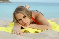 Sunbathing. Girl laying on beach sunbathing Royalty Free Stock Images
