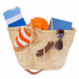 Sunbathing accessories in basket Royalty Free Stock Photography