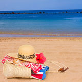 Sunbathing accessories at beach Royalty Free Stock Photos