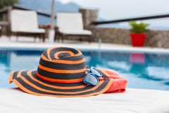 Sunbathing accessories on beach towel Royalty Free Stock Images