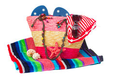 Sunbathing accessories in pink straw bag Royalty Free Stock Photos