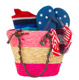 Sunbathing accessories in pink straw bag Stock Images