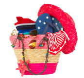 Sunbathing accessories in pink straw bag Stock Photo