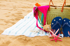Sunbathing accessories on sandy beach Stock Photography