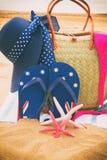 Sunbathing accessories on sandy beach Royalty Free Stock Photography