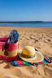 Sunbathing accessories on sandy beach Stock Images