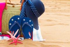 Sunbathing accessories on sandy beach Royalty Free Stock Photos