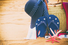 Sunbathing accessories on sandy beach Royalty Free Stock Image