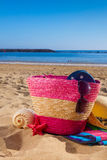 Sunbathing accessories on sandy beach Royalty Free Stock Photos