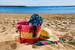 Sunbathing accessories on sandy beach Royalty Free Stock Image