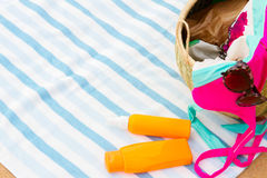 Sunbathing accessories on sandy beach Royalty Free Stock Images