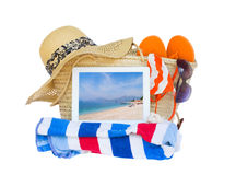 Sunbathing accessories  with sea on tablet Royalty Free Stock Image