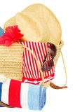 Sunbathing accessories in straw bag Royalty Free Stock Photo
