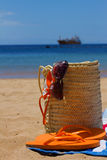 Sunbathing accessories in straw bag Stock Photography
