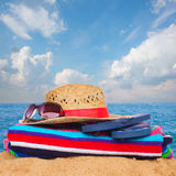 Sunbathing accessories and straw hat on sand Royalty Free Stock Photos
