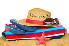 Sunbathing accessories and straw hat on sand Stock Photography