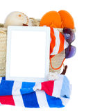 Sunbathing accessories  with tablet Stock Photos