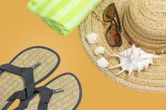 Sunbathing accessory on sand textured background Stock Photography