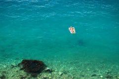 Sunbathing on adriatic waters Royalty Free Stock Image