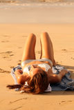 Sunbathing on the beach Royalty Free Stock Photo