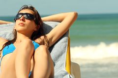 Sunbathing on the beach royalty free stock images