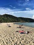 Sunbathing on the beach Stock Images