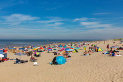 Sunbathing on the beach in Noordwijk. Sunbathing on the beach in with a blue sky Noordwijk the Netherlands Stock Photo