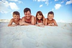 Sunbathing on beach Royalty Free Stock Images