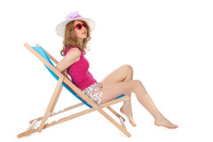 Sunbathing at the beach Stock Images