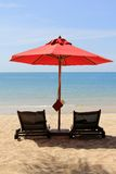 Sunbathing Beds with a Red Umbrella Royalty Free Stock Photography
