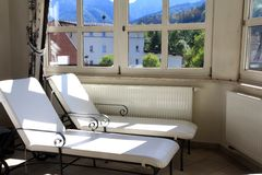 Sunbathing Beds by the window Royalty Free Stock Photo
