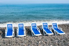 Sunbathing blue beds on the beach Stock Image