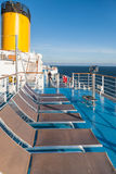 Sunbathing chairs on upper deck of cruise liner Royalty Free Stock Images