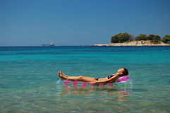 Gorgeous scenic view of young girl sunbathing on A Royalty Free Stock Image