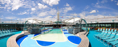 Sunbathing Deck of Legend of the Seas. ROyal Carribean has been advertising heavily in all media, christmas is around the corner, people are traveling and Royalty Free Stock Photography