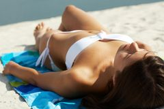 Sunbathing girl Stock Photography