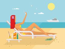 Sunbathing Girl on the Beach Doing Selfie Stock Photography