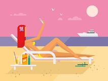 Sunbathing Girl on the Beach Doing Selfie Stock Photos